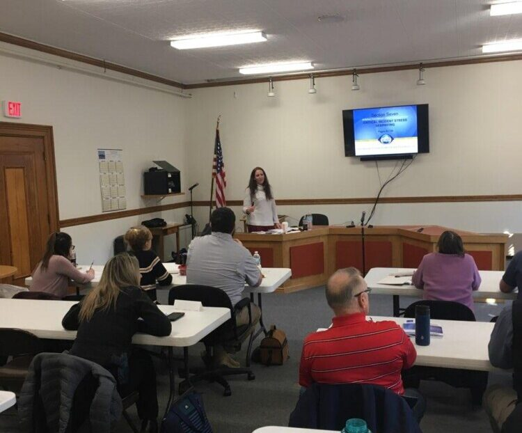 Police officers and mental health care providers attend a class this week in Skowhegan where they were trained in crisis intervention stress management. Hannah Longley, director of community programs at NAMI Maine, taught the course.