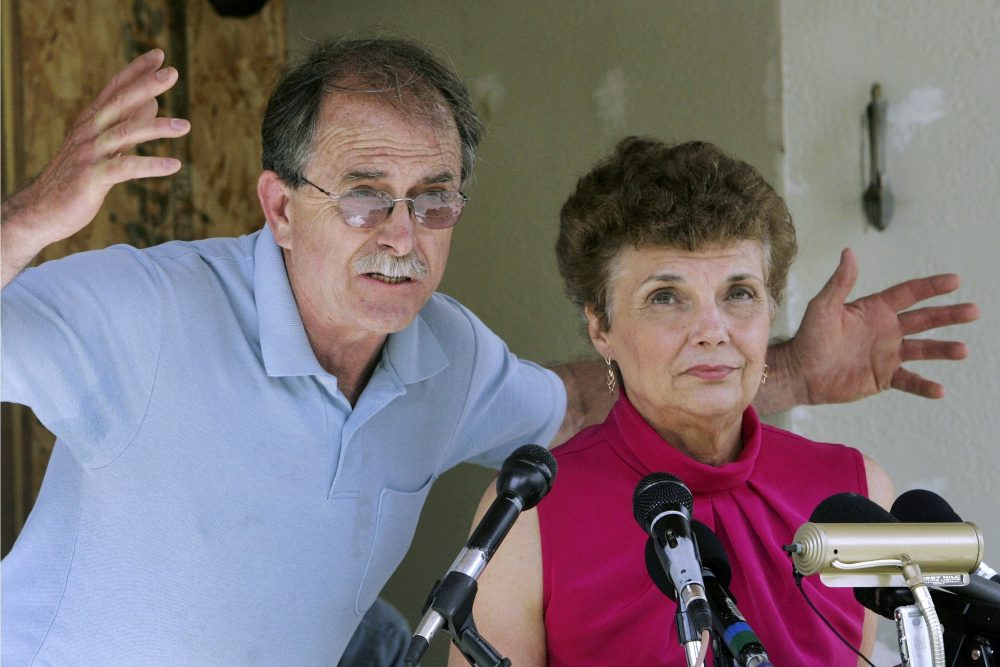 FILE - In this June 18, 2007, file photo, Ed and Elaine Brown talk to reporters during a news conference at their home in Plainfield, N.H., in 2007. Years after they were imprisoned for amassing an arsenal of weapons at their fortress-like home, and holding U.S. marshals at bay after a tax evasion conviction, Elaine Brown said she is ashamed of her actions and seeks a divorce while awaiting re-sentencing in 2020 in light of a recent U.S. Supreme Court ruling.