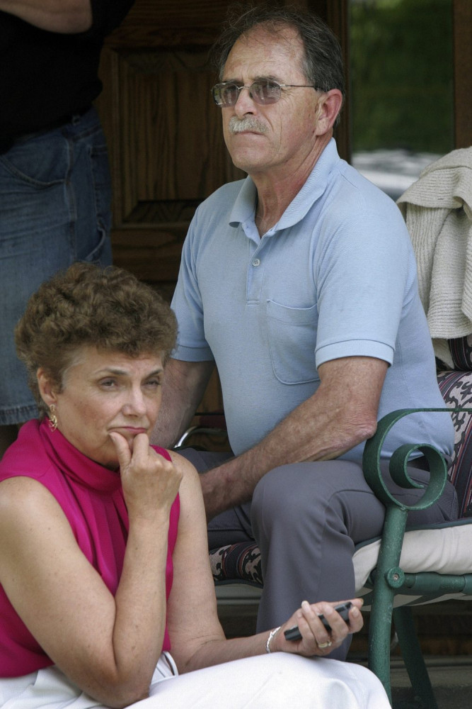 Convicted tax evaders Ed and Elaine Brown sit on their porch in Plainfield, N.H., in 2007. They await re-sentencing this month in light of a recent U.S. Supreme Court ruling.