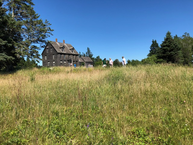 "The Olson house in Cushing in July 2018, viewed from a vantage point similar to Andrew Wyeth's in the painting, ""Christina's World."" The house is open to the public and operated by the Farnsworth Art Museum."