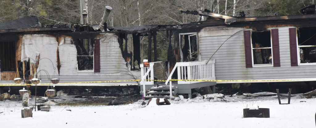 This double wide mobile home on Alley Lane off Route 202  in Troy  was destroyed by fire late Friday. All walls, roof and contents were destroyed, according to officials. Two vehicles, a recreational vehicle and a mobile home did not appear damaged. No one was at the scene Saturday morning but police tape and a No Trespass sign are posted.