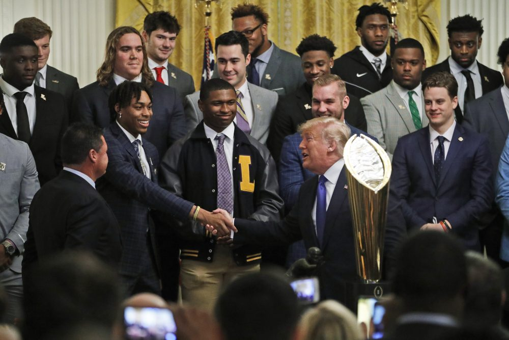 President Donald Trump, right, shakes the hand of LSU wide receiver Justin Jefferson, as he honors the members of the Louisiana State University NCAA college championship football team in the East Room at the White House, Friday.