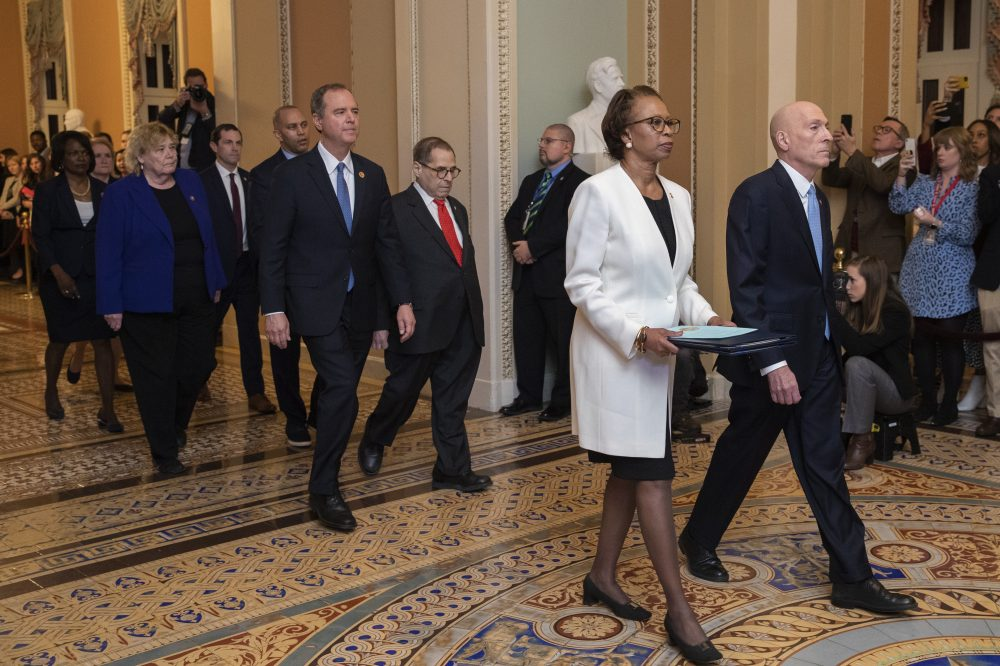 House Sergeant at Arms Paul Irving and Clerk of the House Cheryl Johnson carry the articles of impeachment against President Trump to Secretary of the Senate Julie Adams on Wednesday. Following are impeachment managers, House Judiciary Committee Chairman, Rep. Jerrold Nadler, D-N.Y., House Intelligence Committee Chairman Adam Schiff, D-Calif., Rep. Hakeem Jeffries, D-N.Y., Rep. Sylvia Garcia, D-Texas, Rep. Val Demings, D-Fla., Rep. Zoe Lofgren, D-Calif., and Rep. Jason Crow, D-Colo.