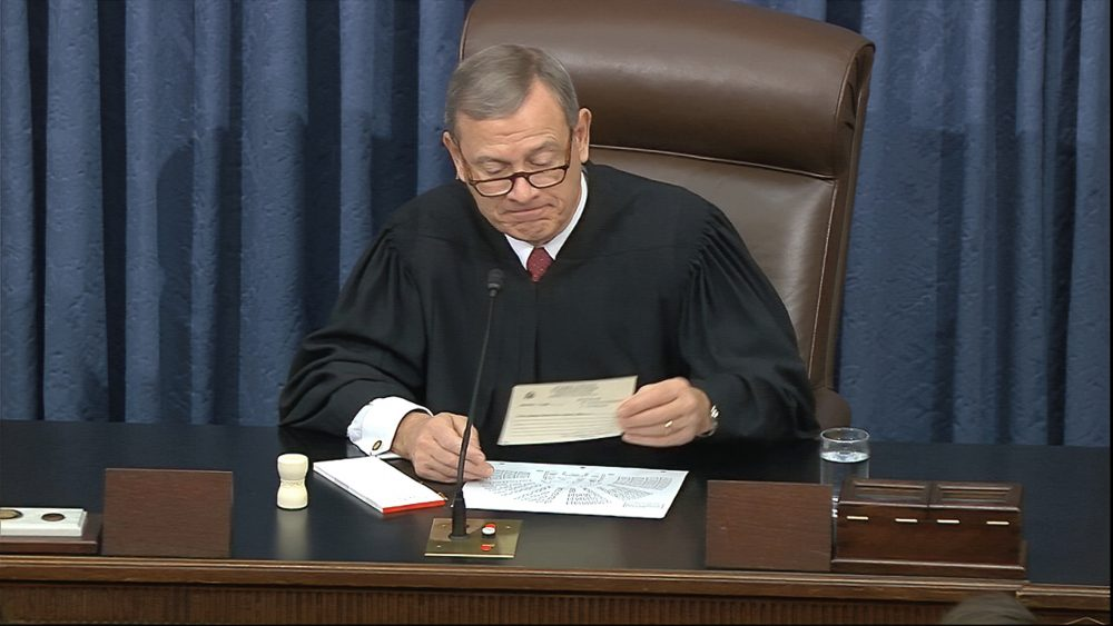 In this image from video, presiding officer Chief Justice of the United States John Roberts reads a question Wednesday during the impeachment trial against President Trump in the Senate at the U.S. Capitol in Washington.