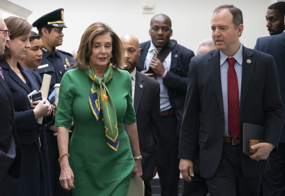 Speaker of the House Nancy Pelosi, D-Calif., joined by House Intelligence Committee Chairman Adam Schiff, D-Calif., leaves a lengthy closed-door meeting with the Democratic Caucus at the Capitol in Washington on Tuesday.