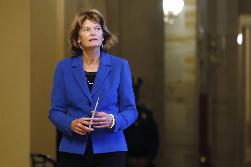 Sen. Lisa Murkowski, R-Alaska, returns to the Senate chamber after a meeting in the majority leader's office during a break in the impeachment trial of President Trump at the U.S. Capitol on Friday. Murkowski voted not to call witnesses or obtain documents for the Senate trial.