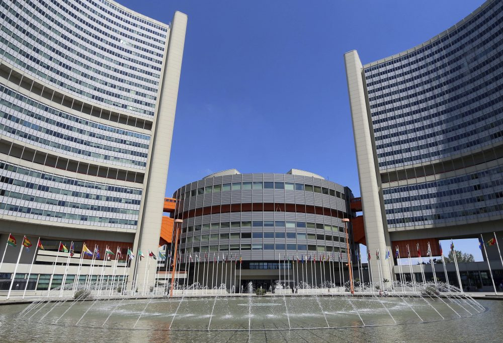 In this June 18, 2014, file photo flags fly outside the United Nations building in Vienna, Austria.