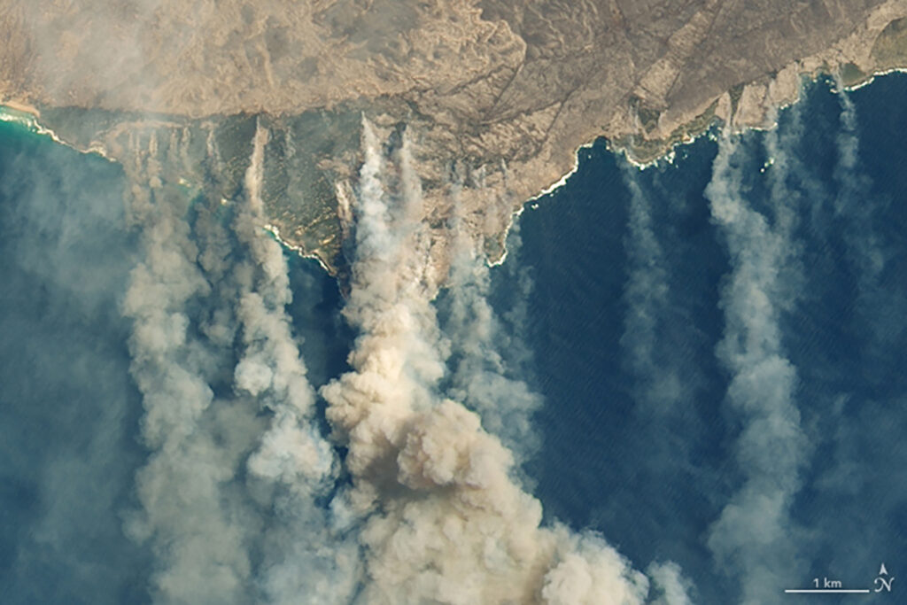 Burned land and thick smoke are visible on  Kangaroo Island, Australia, on Thursday.