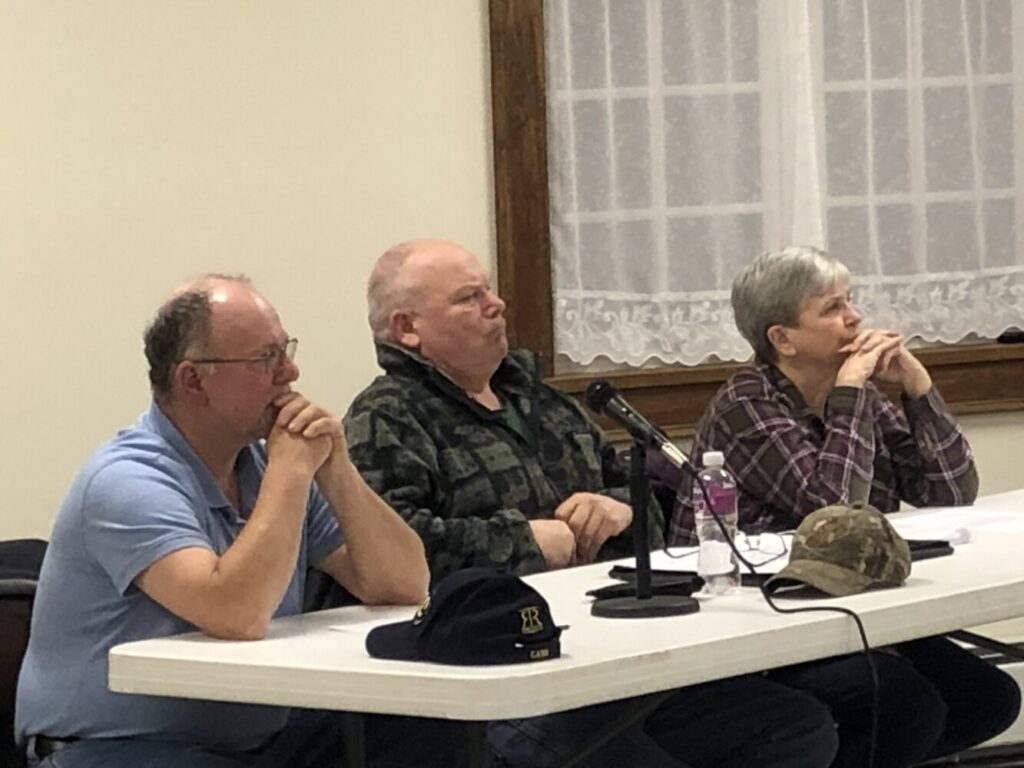 The Dresden Board of Selectmen, from left, Allan Moeller Sr., Gerald Lilly and Trudy Foss, listen to residents Wednesday at a special town meeting where residents voted whether or not to buy the property next to the Town Office.