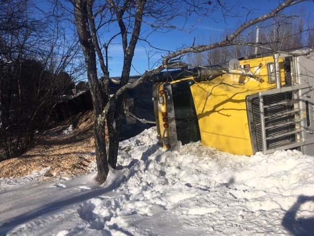 A fully loaded wood chip truck operated by Elwood Yeaton III, of Peru, rolled over on Route 150 in Athens on Monday and stayed on the side of the road for several hours waiting to be towed away. No one was injured in the crash.