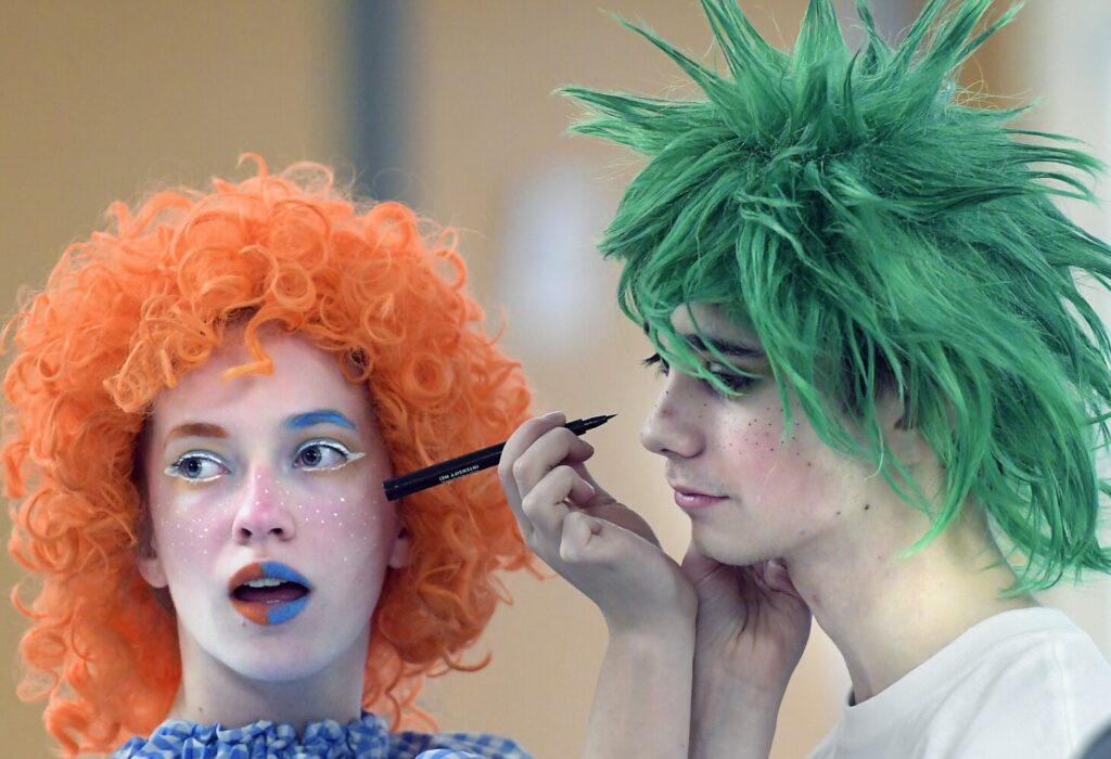 "Gardiner Area High School student Kayla Bailey applies makeup Tuesday to Taylor Sutherburg to perform as munchkins during a dress rehearsal of the Broadway musical ""The Wiz"" in the school's theater. Performances of the 1970s-era remake of the ""Wizard of Oz"" will take place at 7 p.m. Feb. 7-8 in the Gardiner Area High School Little Theater."