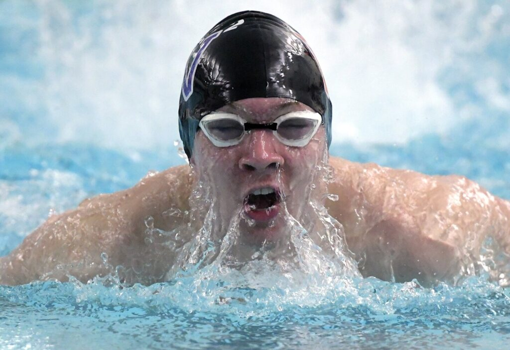 Waterville's Alexander Renaud competes Monday in the Kennebec Valley Athletic Conference Class B swim meet in Bath. Kennebec Journal photo by Andy Molloy