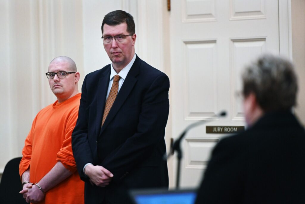 Dustan Bentley, left, who was charged with murder in the death of his roommate last year, listens to Assistant Attorney General Meg Elam during Bentley's plea hearing in York County Superior Court on Tuesday. In the center is Bentley's attorney, Joseph Mekonis.