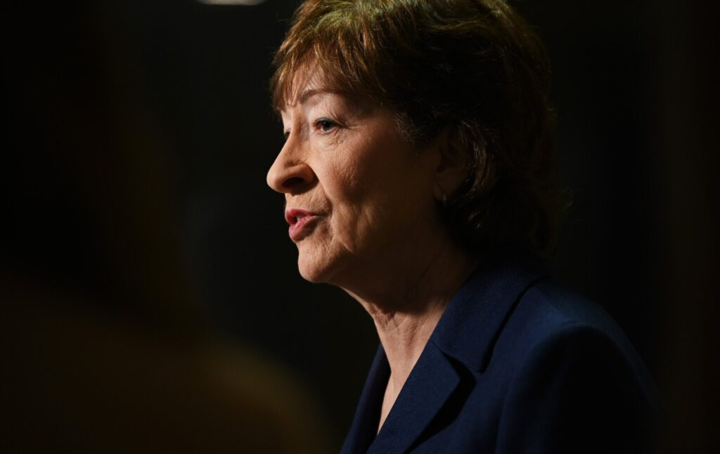 Sen. Susan Collins speaks with reporters Friday after delivering remarks at the Maine Chiefs of Police Association Winter Conference at the DoubleTree by Hilton Hotel in South Portland.   A political scientist at the University of Maine says this could be the senator's toughest re-election battle yet.