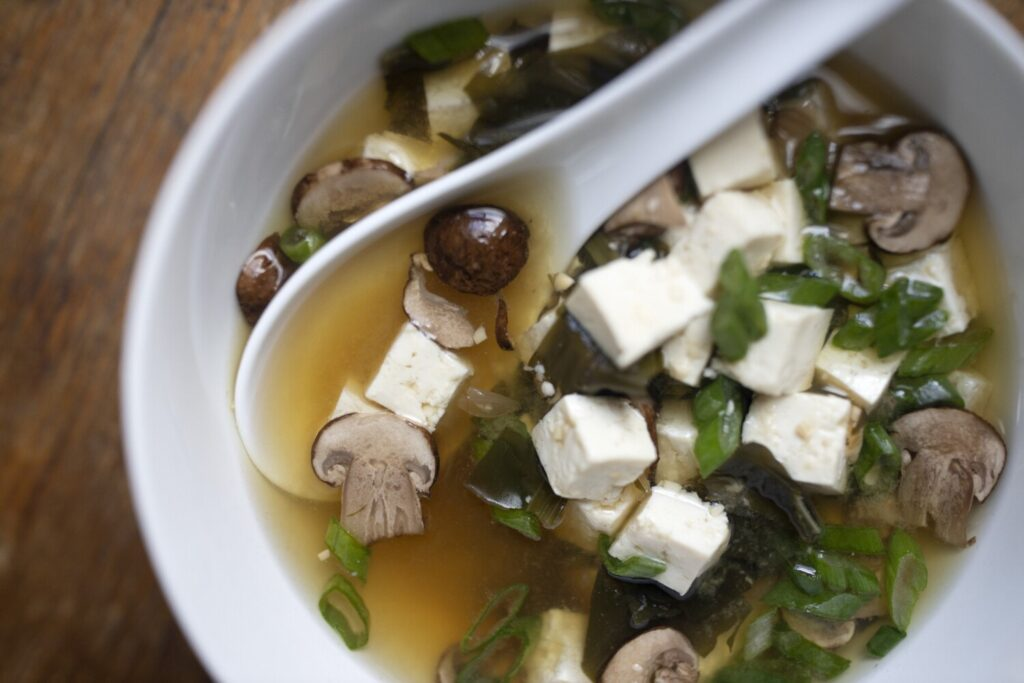 Miso soup with mushrooms and tofu.