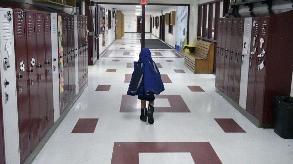 A child walks toward the entrance and lobby at Richmond High School on Wednesday. Residents of the community are considering leaving Regional School Unit 2.