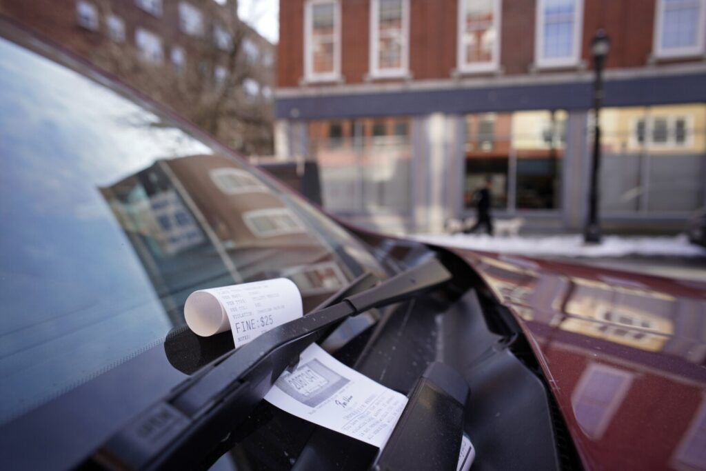 A parking ticket rests under the windshield wiper of a car parked along Main Street in Biddeford on Wednesday.