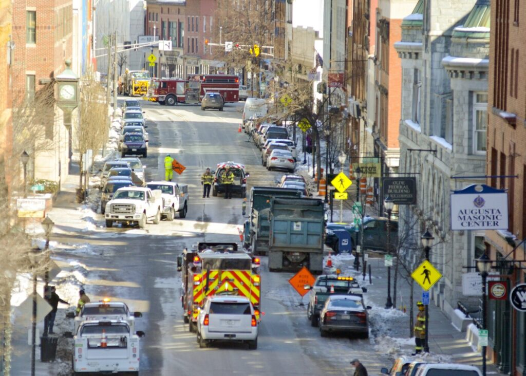 Augusta Fire Department and Summit Natural Gas work Friday at the scene of a gas leak at the corner of Water and Winthrop streets. The road was shut down as officials worked to repair the leak.