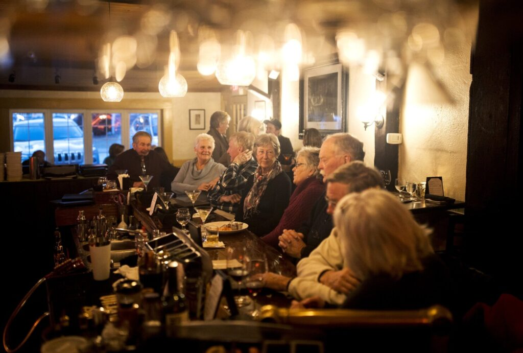 Locals pack The Thistle Inn in Boothbay Harbor on a late February day, continuing a long tradition.