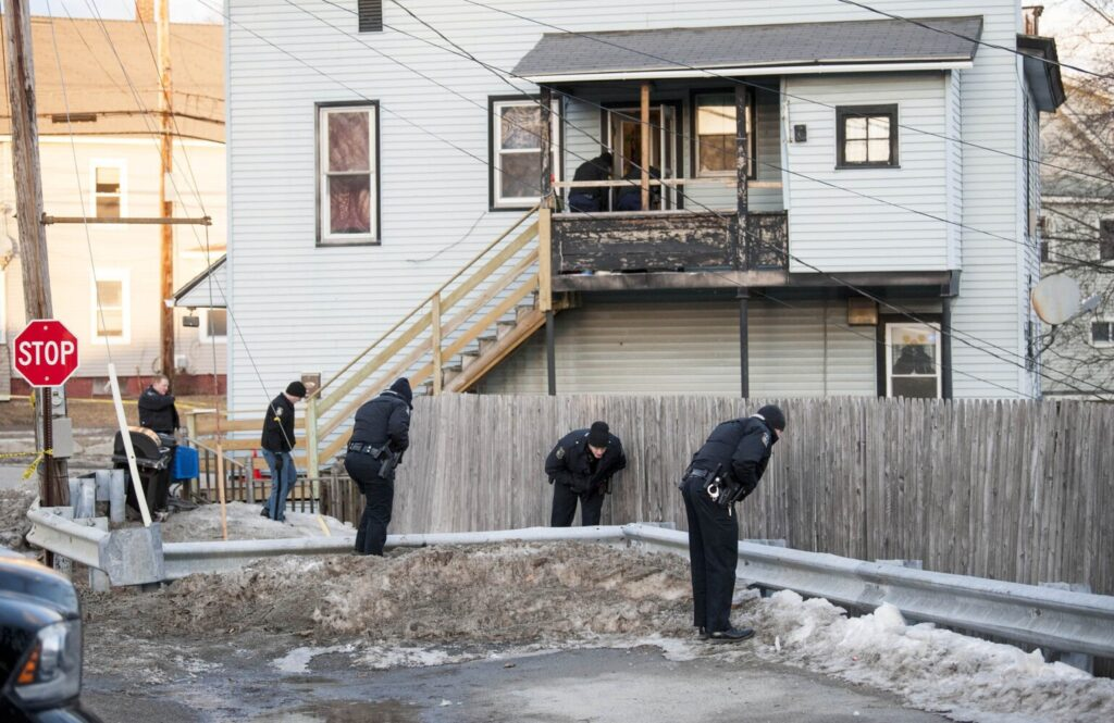 Officers from the Waterville Police Department and Maine State Police search outside the apartment building at 42 Summer St. in Waterville, where Emahleeah Frost, 7, was injured Feb. 28 in a drive-by shooting.