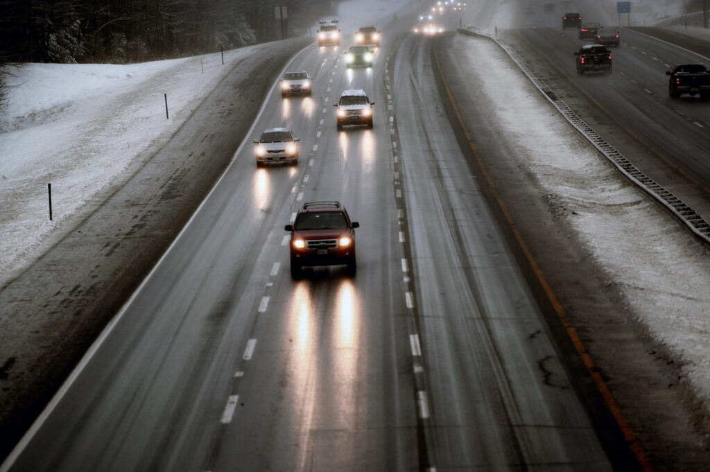 Traffic moves slowly on the Maine Turnpike in Saco as icy weather hit southern Maine on Friday morning.