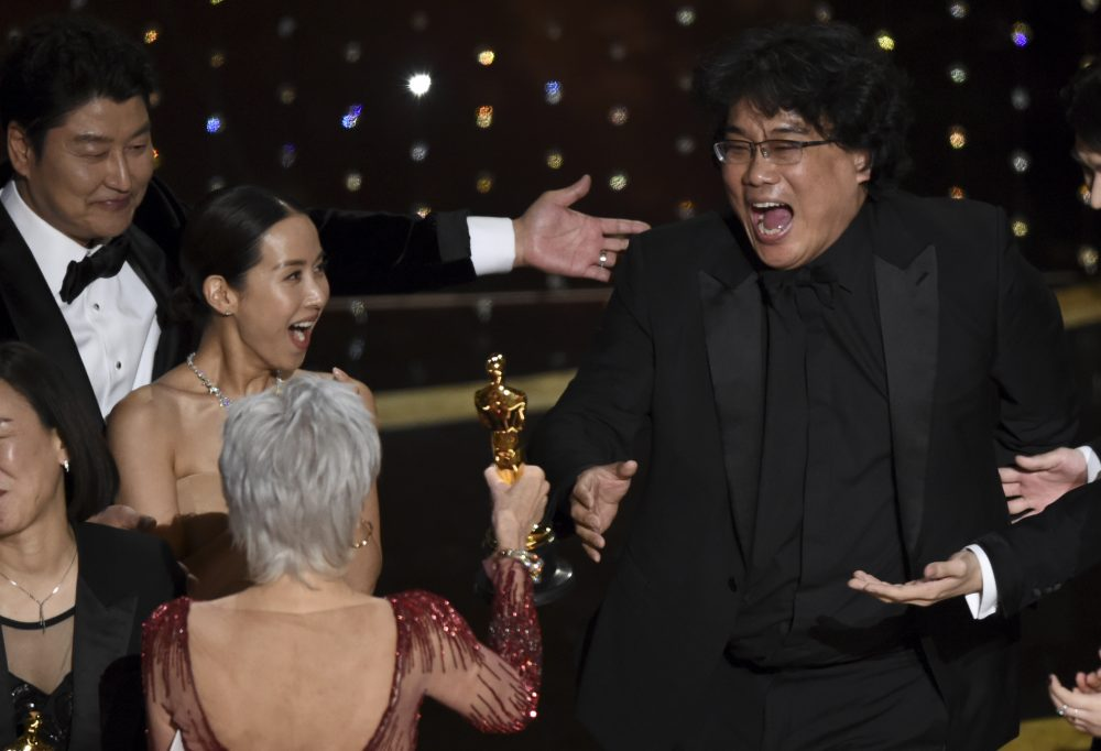 """Bong Joon Ho, right, reacts as he is presented with the award for best picture for """"Parasite"""" from presenter Jane Fonda at the Oscars on Sunday."""