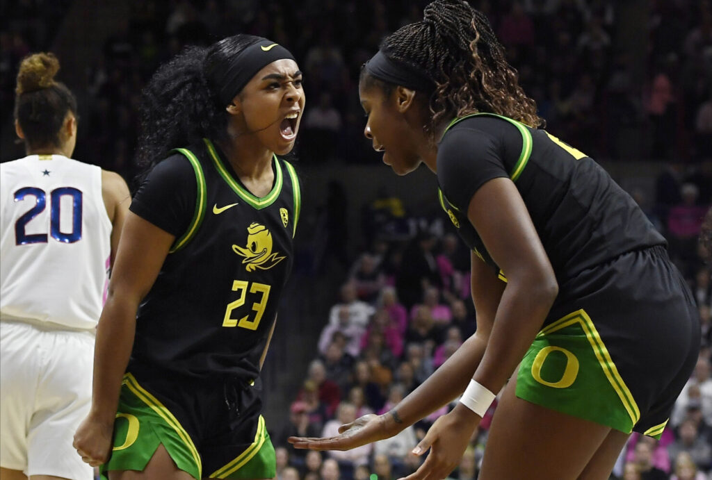 Oregon's Minyon Moore celebrates with teammate Oregon's Ruthy Hebard during the Ducks' 74-56 win over UConn on Monday in Storrs, Connecticut.