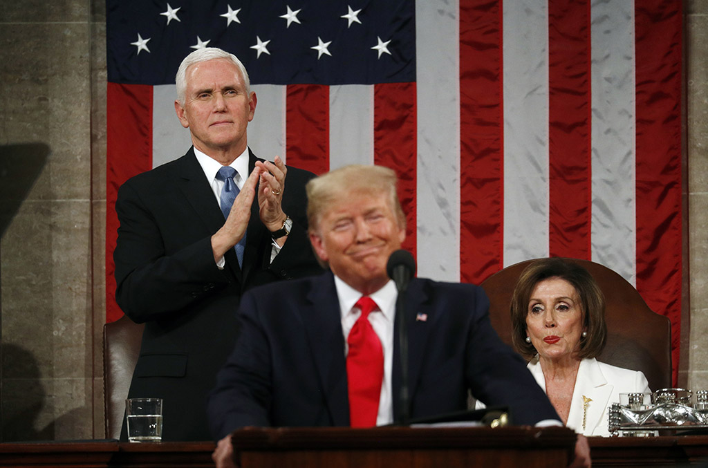 President Trump delivers his State of the Union address Tuesday night to a joint session of Congress as Vice President Mike Pence and House Speaker Nancy Pelosi look on.