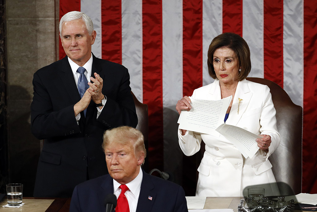 House Speaker Nancy Pelosi tears her copy of President Trump's State of the Union speech after he delivered it to a joint session of Congress on Tuesday night. Vice President Pence is at left.