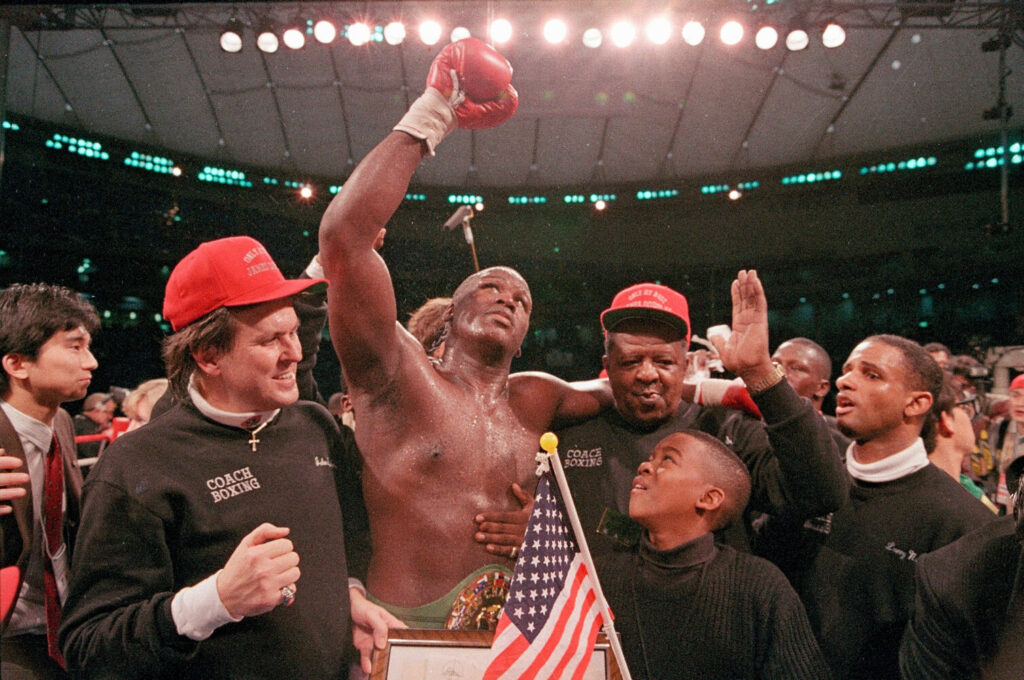 """On Feb. 11, 1990, James """"Buster"""" Douglas celebrated with a cheering crowd following a 10th round knockout victory over Mike Tyson at the Tokyo Dome."""