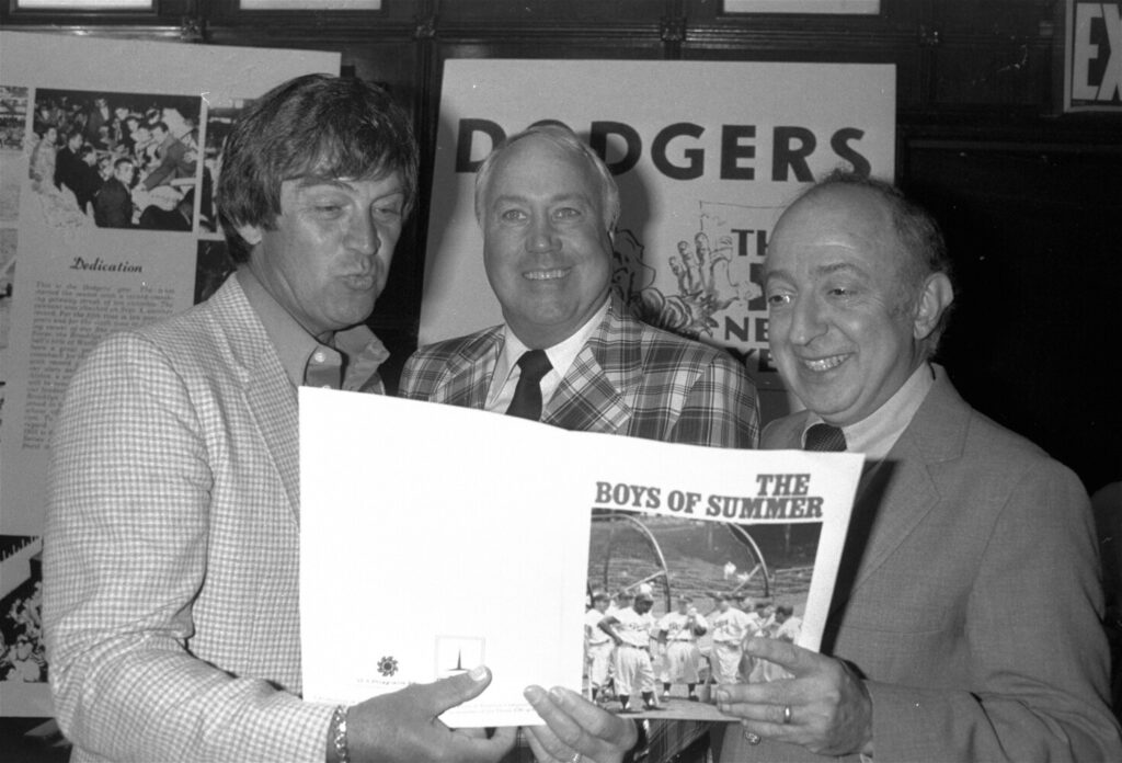 "In this June 24, 1982, file photo, author Roger Kahn, right, joins former Brooklyn Dodger outfielder Duke Snider, center, and former Dodger pitcher, Clem Labine, at the start of production on the television film based on Kahn's best selling book, ""The Boys of Summer,"" in New York. Kahn, the writer who wove memoir and baseball and touched millions of readers through his romantic account of the Brooklyn Dodgers died Thursday at a nursing facility in Mamaroneck, N.Y., according to his son Gordon Kahn. He was 92."