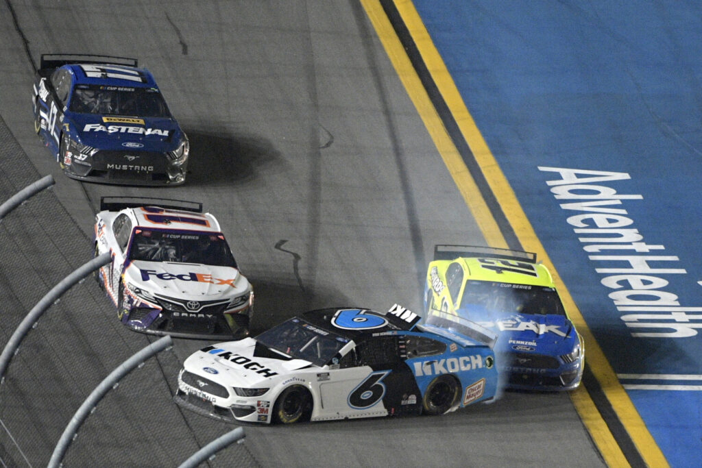 Ryan Newman gets turned into the wall by Ryan Blaney, 12,  as Denny Hamlin misses them along the front stretch on the final lap of the Daytona 500 on Monday. Hamlin won and Newman was in a horrific crash.