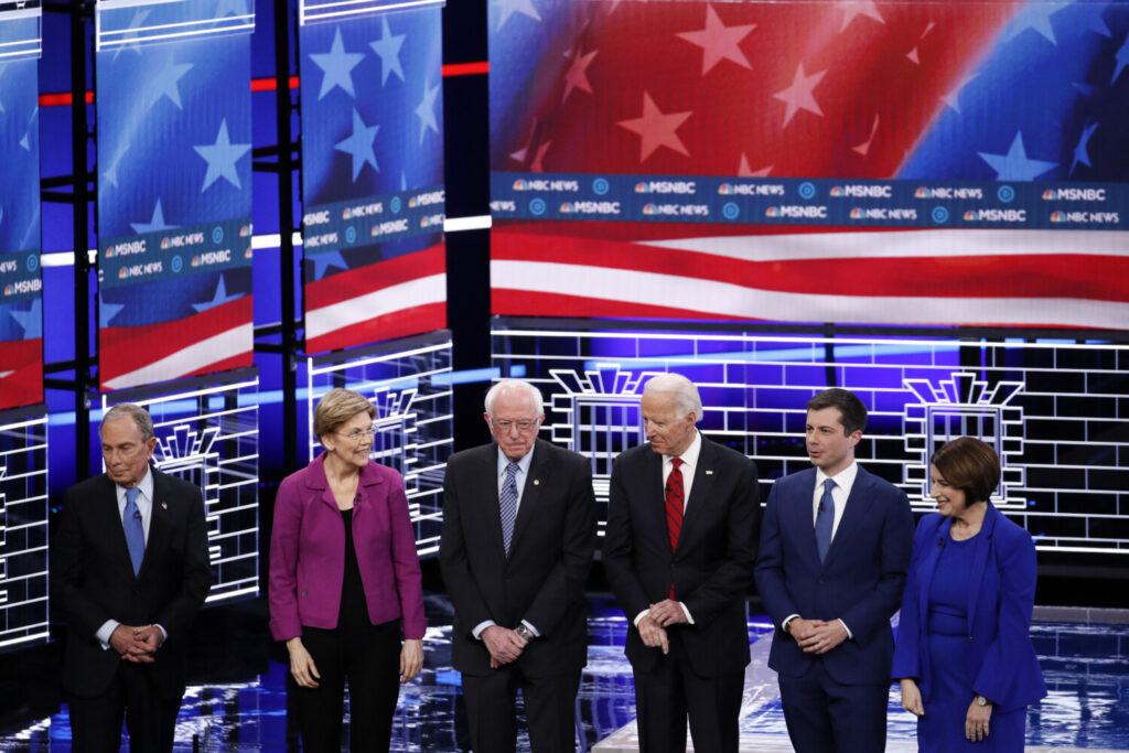Democratic presidential candidates, from left, former New York City Mayor Michael Bloomberg; Sen. Elizabeth Warren, D-Mass.; Sen. Bernie Sanders, I-Vt.; former Vice President Joe Biden; former South Bend Mayor Pete Buttigieg; and Sen. Amy Klobuchar, D-Minn., stand on stage before a debate Wednesday  in Las Vegas, hosted by NBC News and MSNBC.