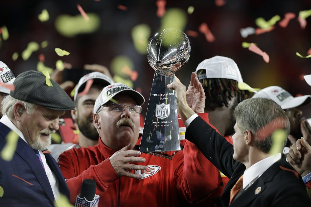 Kansas City Chiefs chairman Clark Hunt, right, hands the trophy to head coach Andy Reid after the Chiefs defeated the San Francisco 49ers 31-20 in the Super Bowl on Sunday night in Miami Gardens, Fla.