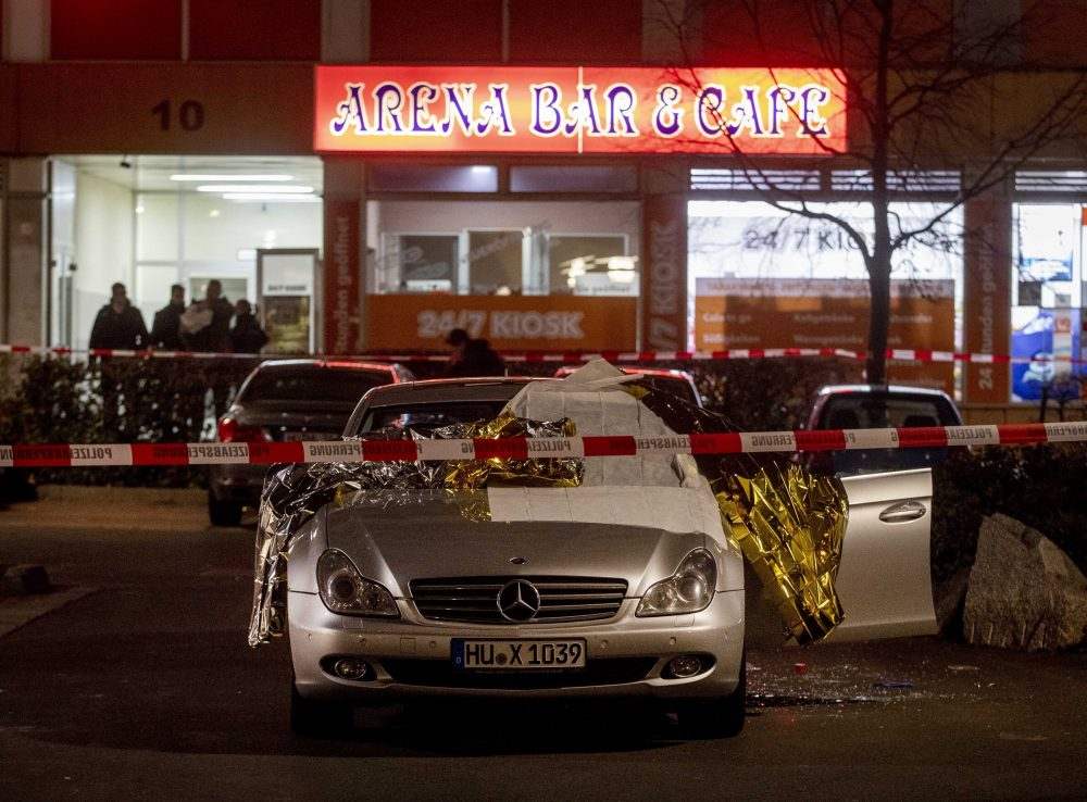 A car with dead bodies stands in front of a bar in Hanau, Germany, on Thursday.