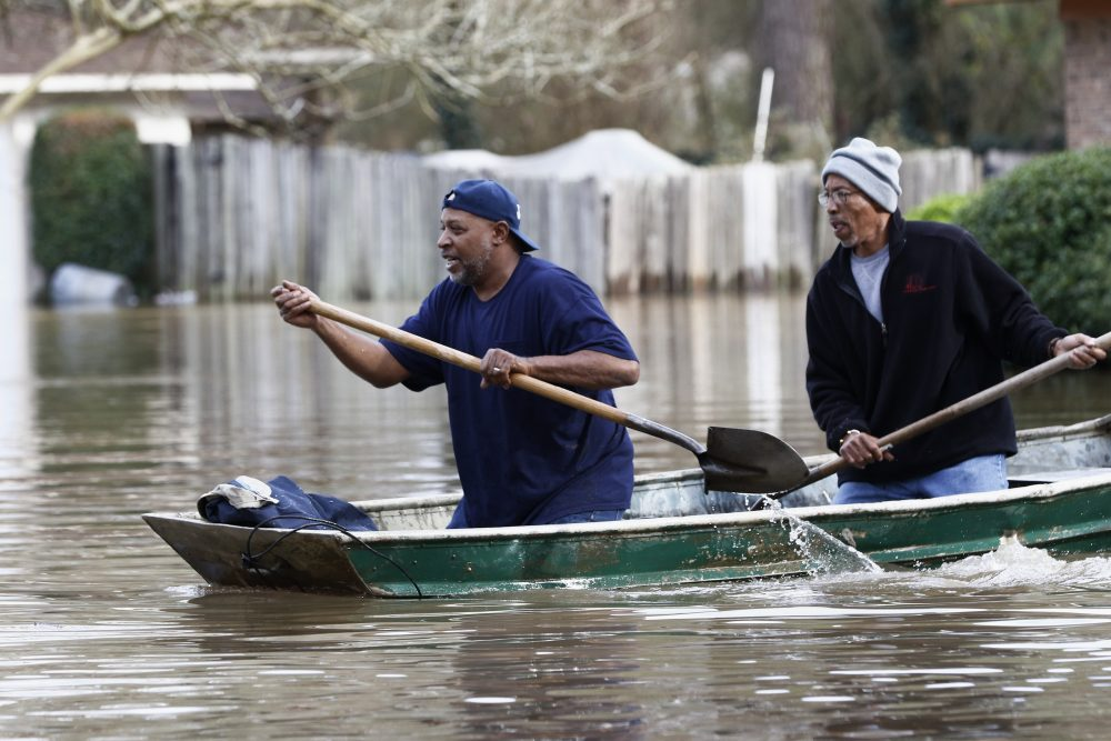 Jackson, Miss., homeowners use shovels to work their way through Pearl River floodwater on Sunday. Residents of Jackson braced Sunday for the possibility of catastrophic flooding in and around the capital as the river rose precipitously after days of torrential rain.