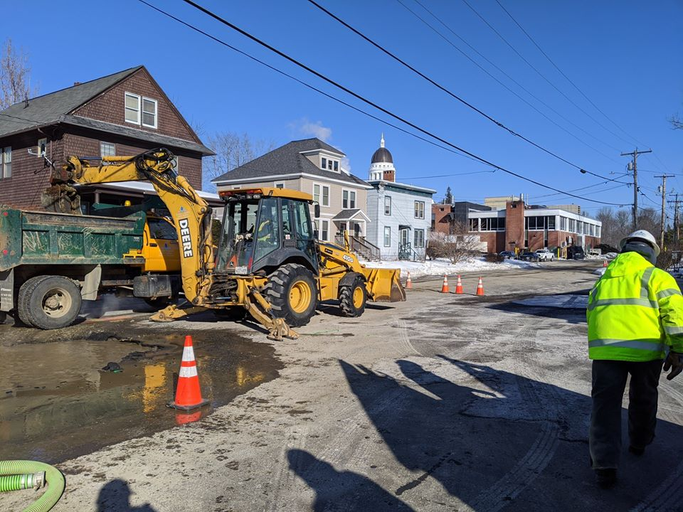 Crews with the Greater Augusta Utility District repair a water main break Friday morning on Columbia Street in Augusta.
