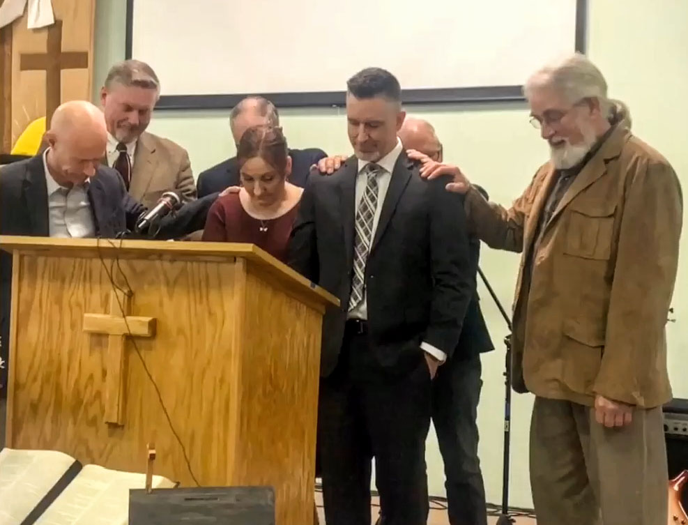 Pastors from Faith Church in Waterville lay hands on Mary and Pastor Benjamin Franklin during a pastoral  installation service Sunday at New Hope Evangelical Free Church in Solon.