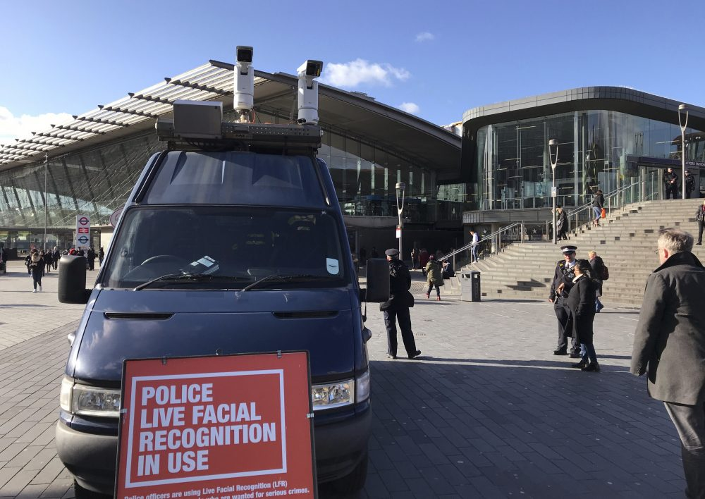 """A mobile police facial recognition facility is parked outside a shopping center on Tuesday in London. """"We don't accept this. This isn't what you do in a democracy,"""" said Silkie Carlo, director of privacy campaign group Big Brother Watch, who are demonstrating against the surveillance.  London police started using facial recognition surveillance cameras  on Tuesday to automatically scan for wanted people. Kelvin Chan/Associated Press"""