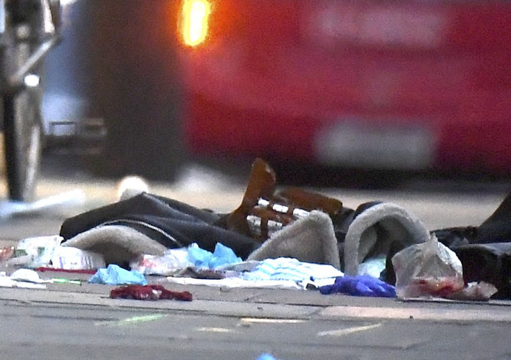 Items remain on the pavement near the scene of a stabbing incident on Streatham High Road in London on Sunday.
