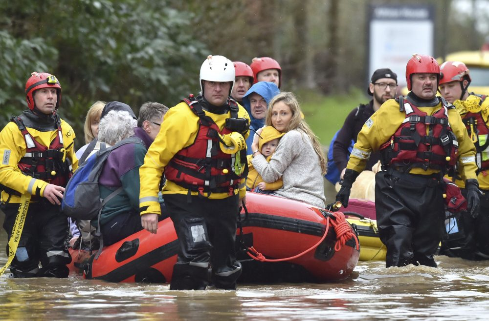 "Rescue operations continue as emergency services take residents to safety, in Nantgarw, Wales, on Sunday. Storm Dennis is roaring across Britain with high winds and heavy rains, prompting authorities to issue 350 flood warnings, including a ""red warning"" alert for life-threatening flooding in south Wales."