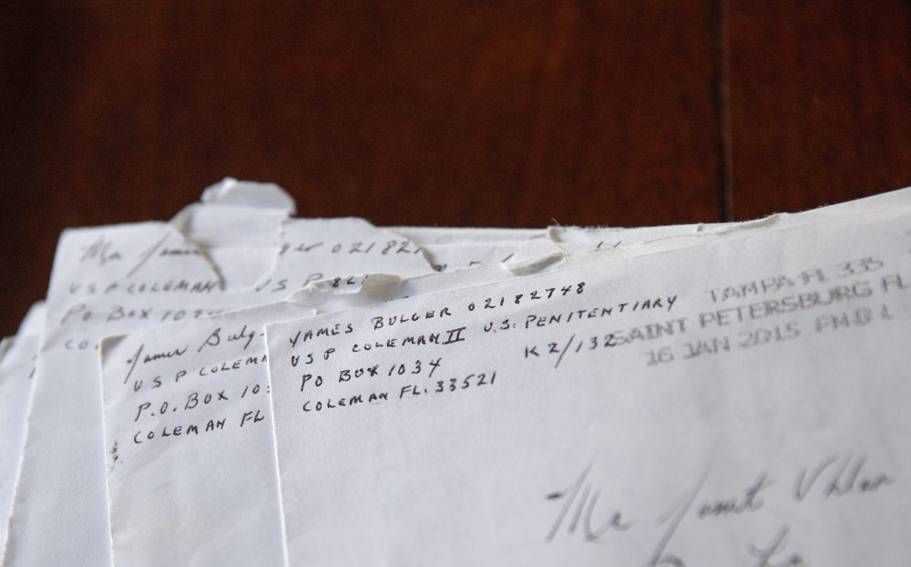 """Letters addressed to Janet Uhlar that she received through her correspondence with imprisoned Boston organized crime boss James """"Whitey"""" Bulger, sit on her dining room table."""