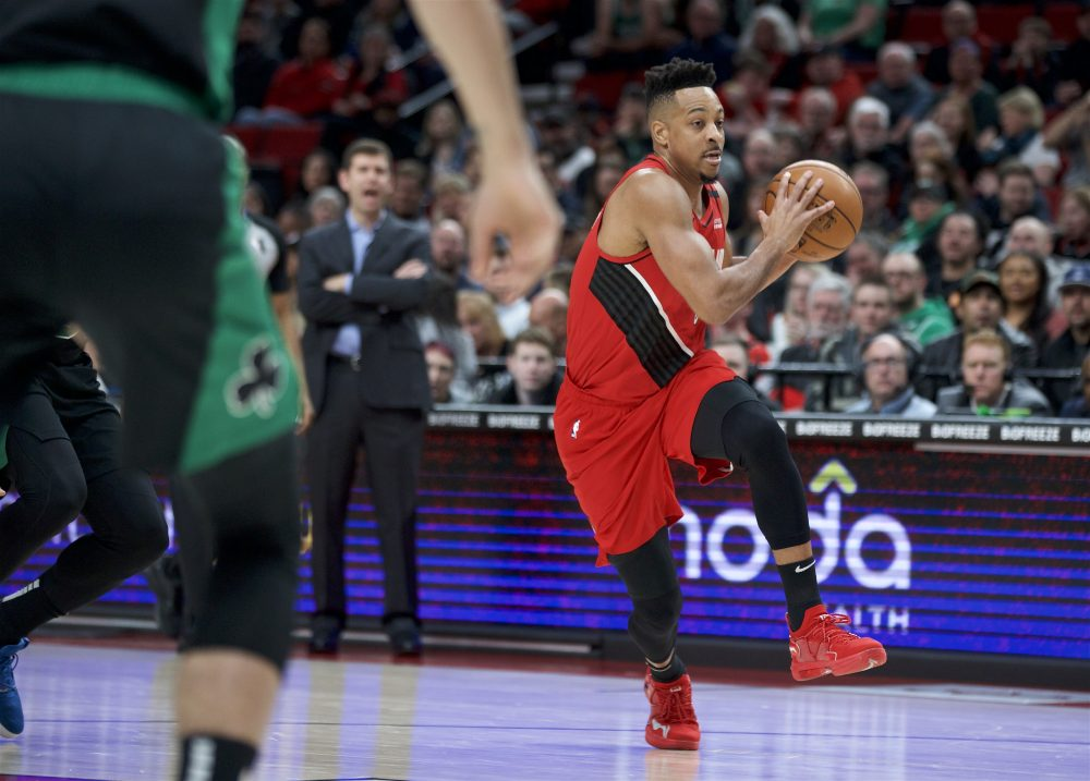 Trail Blazer guard CJ McCollum drives to the basket against the Celtics in the first half of Tuesday night's game in Portland, Ore.