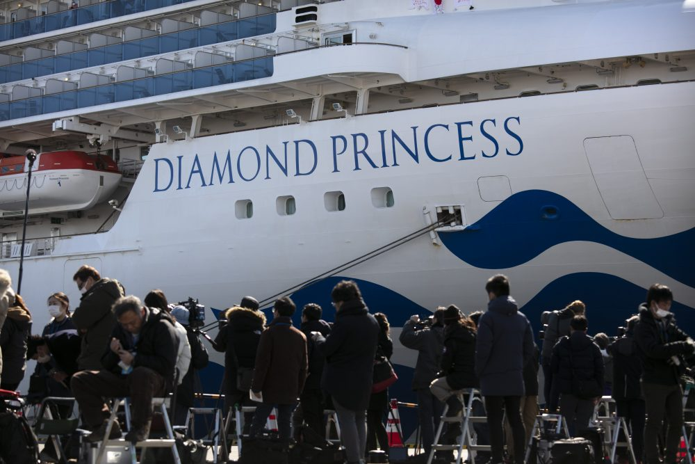 Media gather outside the quarantined Diamond Princess cruise ship in Yokohama, near Tokyo.