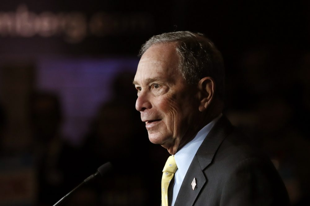Democratic presidential candidate and former New York City Mayor Michael Bloomberg talks to supporters Tuesday in Detroit.   Carlos Osorio/Associated Press