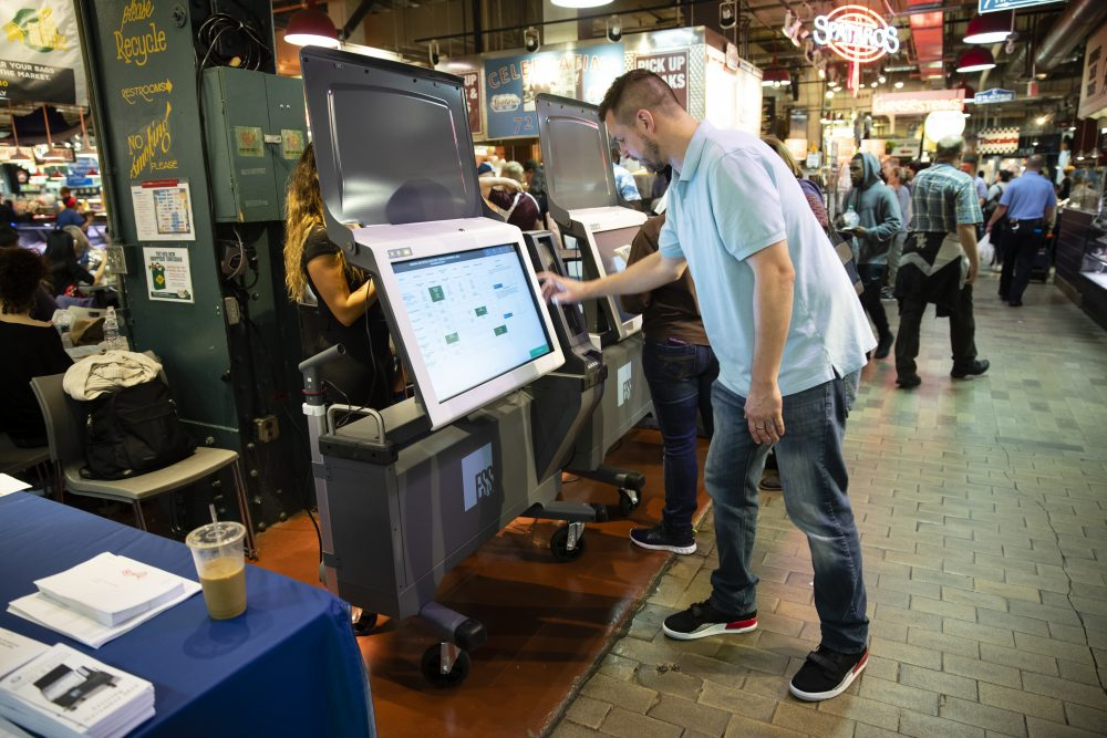 Steve Marcinkus, an Investigator with the Office of the City Commissioners, demonstrates the ExpressVote XL voting machine at the Reading Terminal Market June 13, 2019, in Philadelphia.