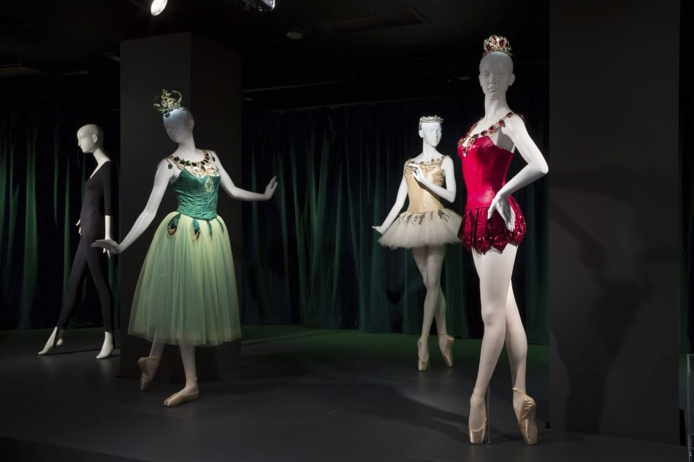"""This photo provided by The Museum at FIT shows a black cotton/Lycra spandex knit unitard, circa 1980, by Bonnie August for Danskin, and Barbara Karinska's """"Emeralds,"""" """"Diamonds,"""" and """"Rubies"""" costumes from """"Jewels,"""" originals designed in 1967, that are part of the new exhibit at the Fashion Institute of Technology in New York. The exhibit features 90 items, including ballet costumes, high fashion and athletic wear, or what we call today """"athleisure."""""""