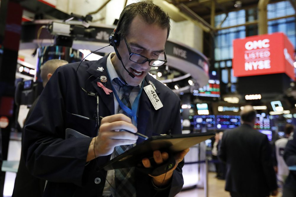 Trader Gregory Rowe works on the floor of the New York Stock Exchange on Monday.