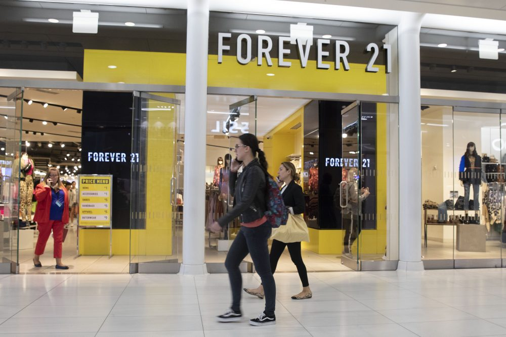 People walk in front of a Forever 21 clothing store in New York in September.