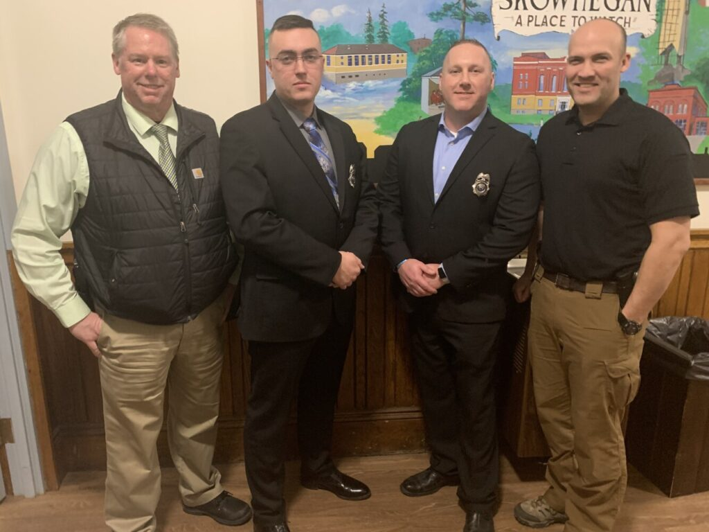 Skowhegan police Chief David Bucknam, left, swore in two officers to the Skowhegan Police Department on Tuesday night: second from left, Officer Isaac Wacome; and second from right Officer Jacob Pierce. Deputy Chief Brian Gardiner is at right.